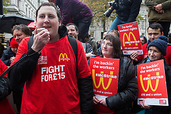 London, UK. 12 November, 2019. Lewis Baker, a striking McDonald's worker from Crayford, addresses McDonald's workers belonging to the Bakers Food & Allied Workers Union (BFAWU) assembled opposite Downing Street during strike action, dubbed a 'McStrike', to call for a New Deal for McDonald's Workers which would include £15 an hour, an end to youth rates, the choice of guaranteed hours of up to 40 hours a week, notice of shifts four weeks in advance and union recognition.