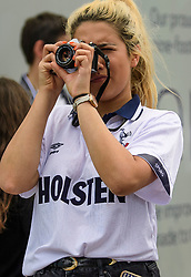 © Licensed to London News Pictures. 14/05/2017. London, UK. Woman takes a picture of the old White Heart Lane, in North London where Tottenham Hotspur F.C. are playing their final game at the ground, against Manchester united today (Sun). Known as 'The Lane', Tottenham have been playing at the ground for 118 years, but will be playing at Wembley next season while a new 60,000 seat stadium is built for the start of the 2018/19 season.  Photo credit: Ben Cawthra/LNP