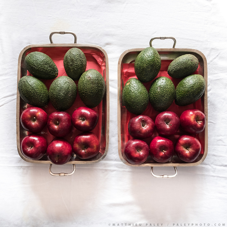 """Avocado and apples. Traditional wedding gifts are prepared by the grrom's family for the bride. <br /> Called """"Saipata"""", they come in pairs as it is considered auspicious."""