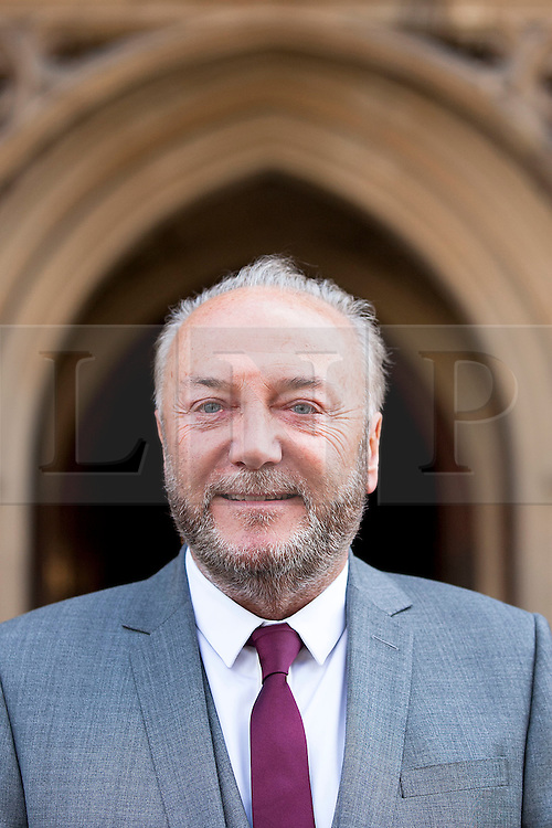 © Licensed to London News Pictures. 16/04/2012. LONDON, UK. George Galloway stands outside the houses of Parliament ahead of his being sworn in as the Respect Party's MP for Bradford West. Photo credit: Matt Cetti-Roberts/LNP