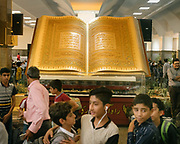 The holy Coran on display at the Tehran train station, in the capital of Iran.<br /> <br /> Travelling over 4000km by train across Iran. An opportunity to enjoy Persian hospitality, discover Iran's ancient cities and its varied landscapes, from deserts to mountains.