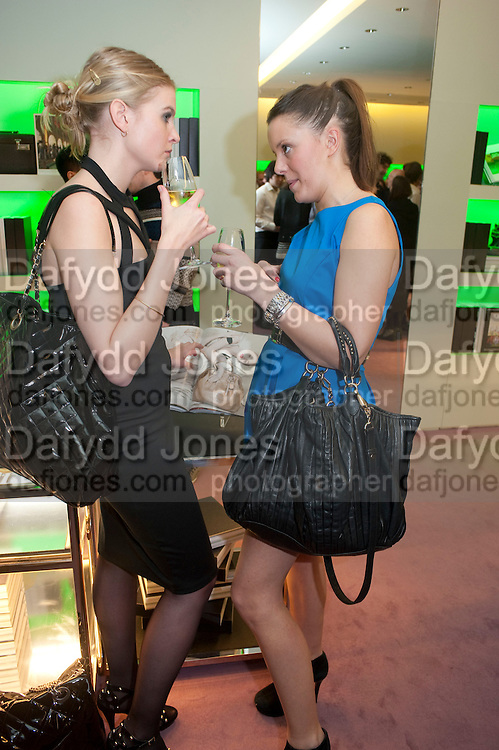 ROSE SIMMONDS; ALICE FARQUHAR;, Prada presents a book documenting the company's diverse projects in fashion, architecture, film and art. Prada Shop. 16/18 Old Bond St. London W1. *** Local Caption *** -DO NOT ARCHIVE-© Copyright Photograph by Dafydd Jones. 248 Clapham Rd. London SW9 0PZ. Tel 0207 820 0771. www.dafjones.com.<br /> ROSE SIMMONDS; ALICE FARQUHAR;, Prada presents a book documenting the company's diverse projects in fashion, architecture, film and art. Prada Shop. 16/18 Old Bond St. London W1.