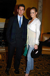 The HON.JAMES TOLLEMACHE and LADY ELOISE ANSON at a party to celebrate the launch of Michelle Watches held at the Blue Bar, The Berkeley Hotel, London on 7th October 2004.<br /><br />NON EXCLUSIVE - WORLD RIGHTS