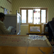 Egyptian men vote in a polling station at Masr El Gdeeda district in Cairo.