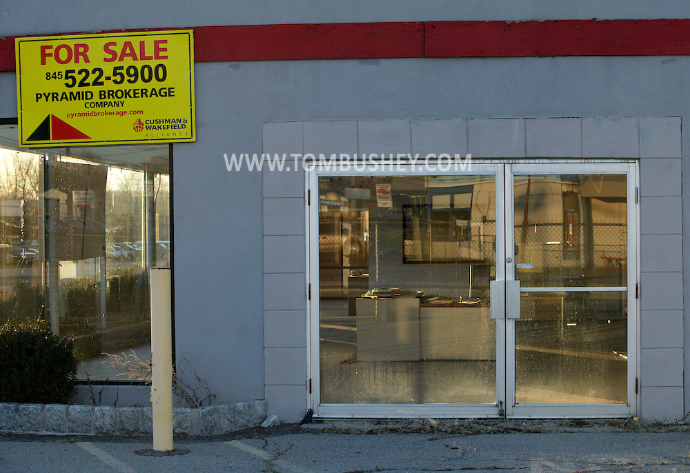 New Hampton, New York - For sale signs are posted on a vacant building, formerly a car dealership, on March 19, 2011.