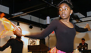 5/5/05 Omaha Neb. Erin Eley, 10, dances at a reception at the Love Jazz and Arts Center Thursday evening. Eley was part of the Eugene Willis Skinner Magnet school dance ensemble. (chris machian/Prairie Pixel Group)