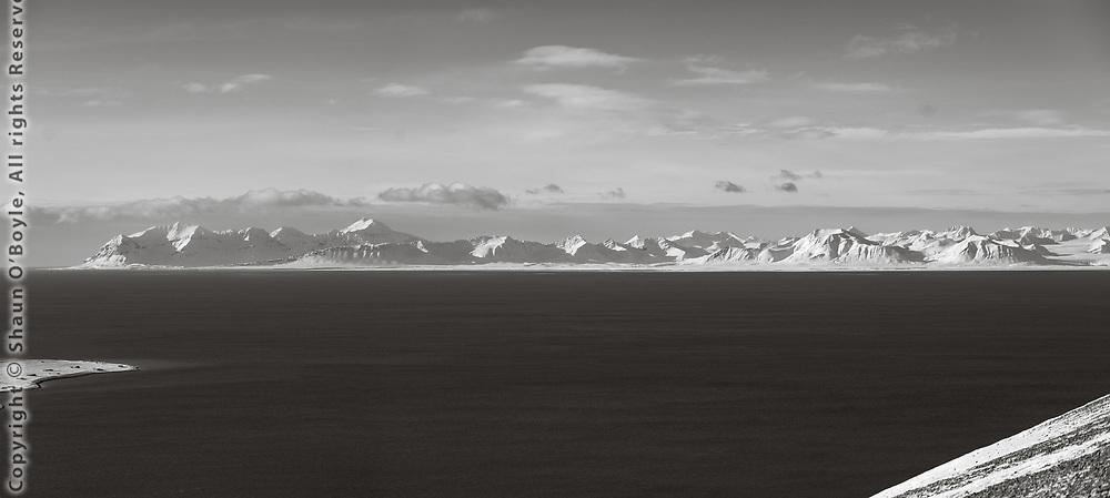 Across Isfjorden is Trollheimen (Home of Trolls), Oscar II Land, Svalbard.