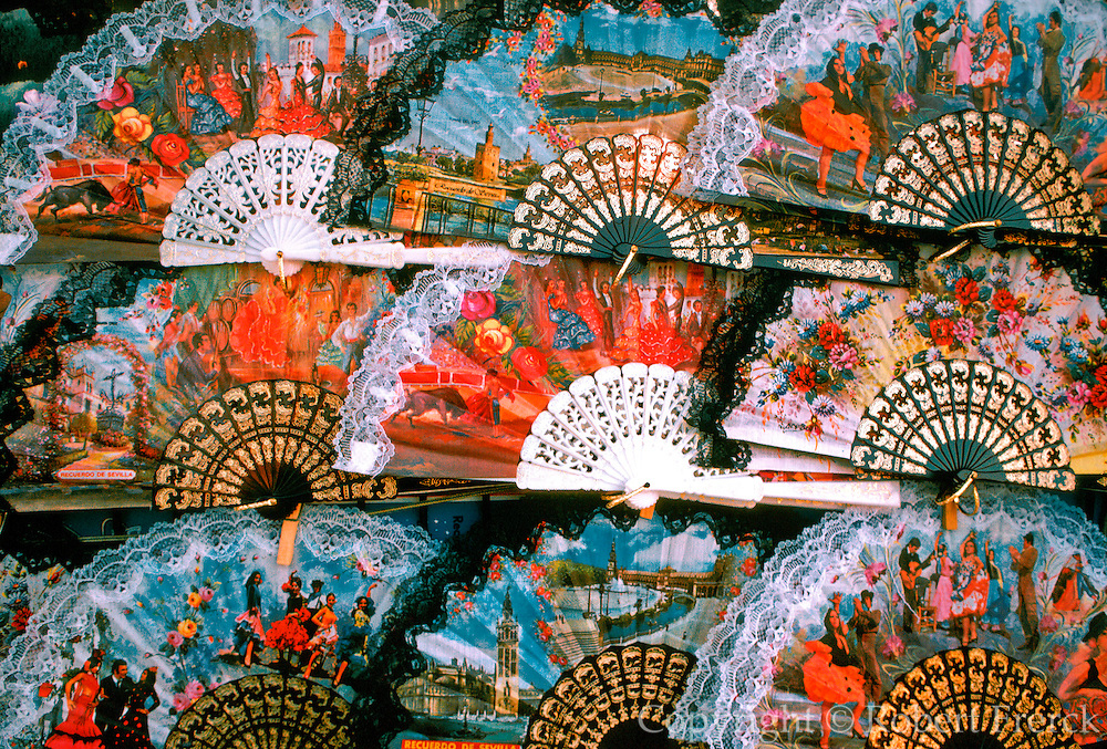 SPAIN, ANDALUCIA Seville, vendor with fans and souvenirs for tourists