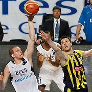 Efes Pilsen's Sinan GULER (L) and Fenerbahce's Marko TOMAS (R) during their Turkish Basketball Legague Play-Off semi final second match Efes Pilsen between Fenerbahce at the Sinan Erdem Arena in Istanbul Turkey on Friday 27 May 2011. Photo by TURKPIX