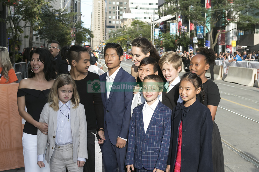 September 11, 2017 - Toronto, Canada - Loung Ung (l-r), Vivienne Jolie-Pitt, Maddox Jolie-Pitt, Pax Jolie-Pitt, Kimhak Mun, Knox Jolie-Pitt, Shiloh Jolie-Pitt, Angelina Jolie, Zahara Jolie-Pitt and Sareum Srey Moch arriving at the premiere of 'First They Killed My Father' during the 42nd Toronto International Film Festival at the Princess of Wales Theatre on September 11 2017 in Toronto, Canada  (Credit Image: © Famous/Ace Pictures via ZUMA Press)