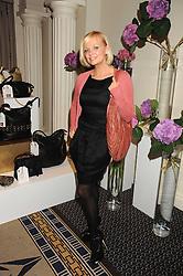 EMMA BUNTON at the In Style Handbag Auction is association with Revlon raising money for the Rainbow Trust children's charity held at the Berkeley Hotel, Knightsbridge, London on 4th November 2008.