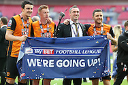 """Harry Maguire of Hull City, Sam Clucas of Hull City and Alex Bruce of Hull City pose with """"We're Going Up!"""" flag. Skybet football league Championship play off final match, Hull city v Sheffield Wednesday at Wembley Stadium in London on Saturday 28th May 2016.<br /> pic by John Patrick Fletcher, Andrew Orchard sports photography."""