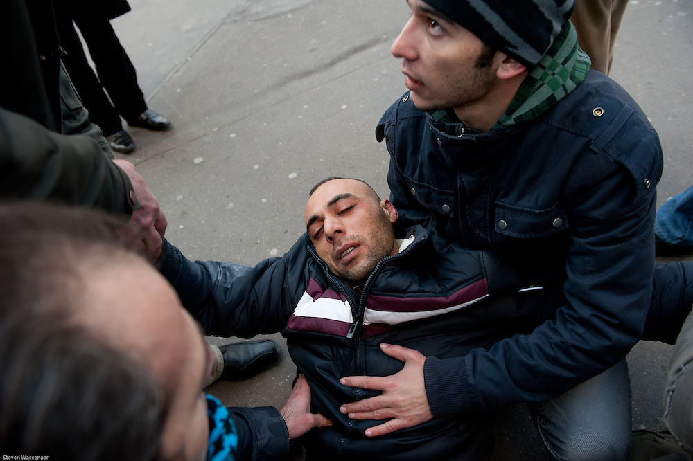 Wounded Anti Bachar Al Assad demonstator after clash of pro and anti Bachar Al Assad demonstators before Russian Ambassy, Paris, France.