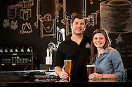 21 SEPT. 2015 -- MARYLAND HEIGHTS, Mo. -- Brewer Ryan Sherring and his wife and business partner Lindsay Sherring pose for a photograph in the tasting room at Six Mile Bridge, a brewery and tasting room in Maryland Heights Monday, Sept. 21, 2015. Ryan Sherring is a South African native and his wife Lindsay Sherring is a native St. Louisan. Their business opened earlier this year. Photo © copyright 2015 Sid Hastings.