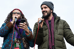 London, UK. 9th February, 2019. MC Dizraeli (r) entertains activists from Extinction Rebellion blocking Kingsland Road in Dalston as part of a 'Saturday street party' intended as a means of engagement around climate change and environmental issues with the local community.