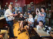 27 JULY 2019 - INDIANOLA, IOWA: A woman uses her smart phone to photograph US Senator MICHAEL BENNET (D-CO) while he talks to a group of central Iowa voters at a cafe in Indianola Saturday. Sen. Bennet is running for the Democratic nomination for the US Presidency in the 2020 election. Iowa traditionally hosts the the first election event of the presidential election cycle. The Iowa Caucuses will be on Feb. 3, 2020.           PHOTO BY JACK KURTZ