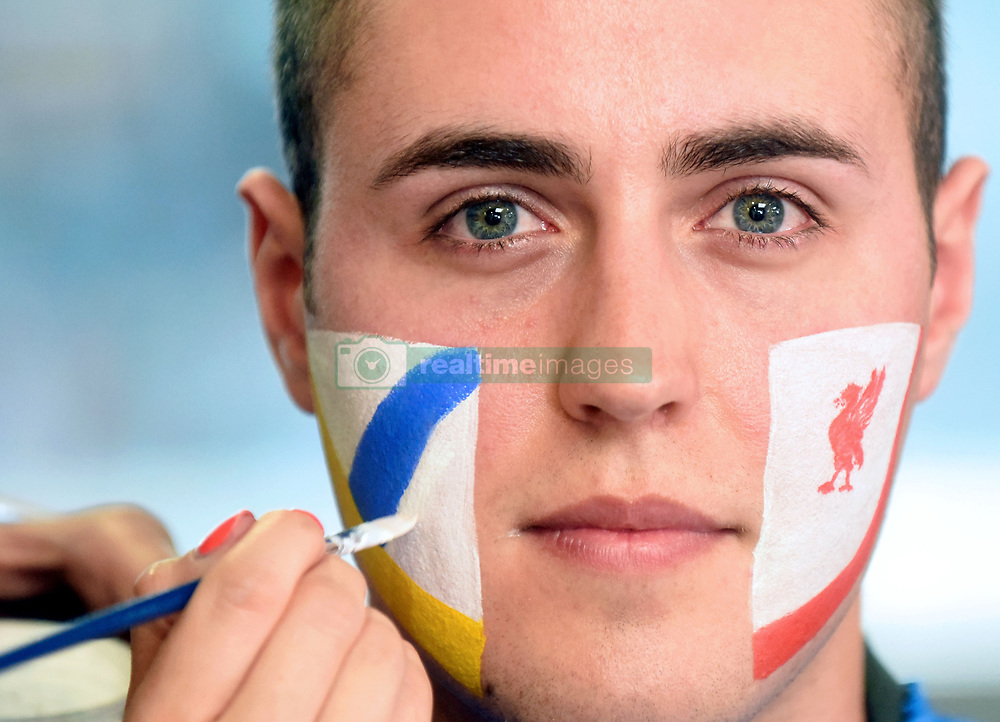May 25, 2018 - Kyiv Region, Ukraine - A serviceman of the State Border Guard Service of Ukraine gets his face painted with the logos of Liverpool F.C. and Real Madrid C.F. in order to greet the fans arriving for the 2018 UEFA Champions League final at Boryspil International Airport, Kyiv Region, northern Ukraine, May 25, 2018. Ukrinform. (Credit Image: © Olena Khudiakova/Ukrinform via ZUMA Wire)