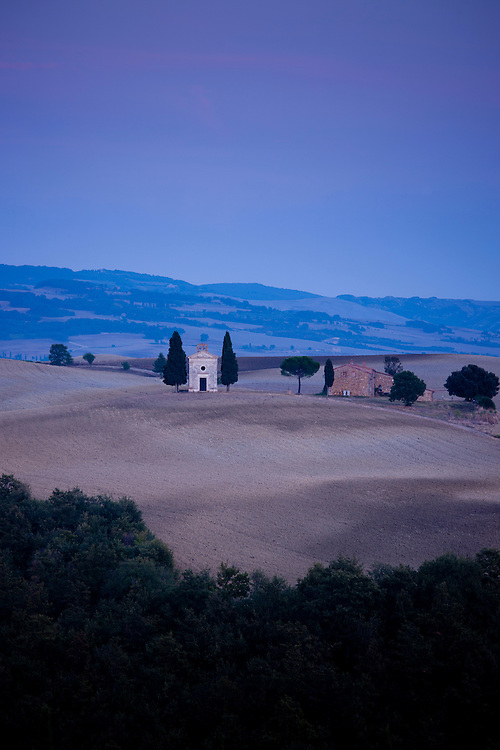 Chapel, Chiesetta di Vitaleta, and typical Tuscan homestead at San Quirico D'Orcia near Pienza  in Val D'Orcia, Tuscany, Italy