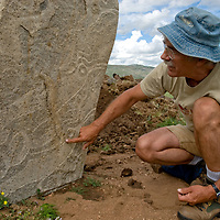 Smithsonian archaeologist Dr. William Fitzhugh studies a 2700+ year-old, bronze age Deer Stone at Ulaan Tolgoi, near Lake  Erkhel & Muren, Mongolia.