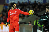 Petr Cech, the Chelsea goalkeeper is handed the ball by a Swansea ballboy. .Barclays Premier League match, Swansea city v Chelsea at the Liberty Stadium in Swansea, South Wales on Saturday 17th Jan 2015.<br /> pic by Andrew Orchard, Andrew Orchard sports photography.