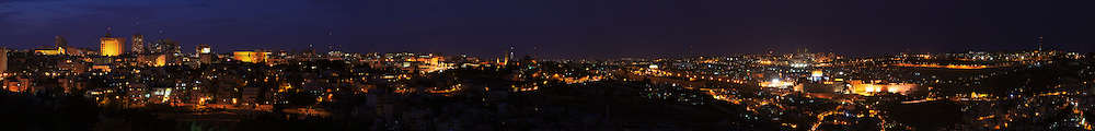 Panoramic night view of new and old Jerusalem from the Haas Promenade (Tayelet), located in the Talpiot neighborhood southeast of the city center. WATERMARKS WILL NOT APPEAR ON PRINTS OR LICENSED IMAGES.