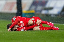 Adam Lallana of Liverpool holds his leg in pain - Photo mandatory by-line: Rogan Thomson/JMP - 07966 386802 - 16/03/2015 - SPORT - FOOTBALL - Swansea, Wales — Liberty Stadium - Swansea City v Liverpool - Barclays Premier League.