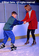 Exercise, Mother and Teen Son Ice Skate,