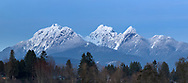 Blue hour view of the Golden Ears (Mount Blanshard) as photographed from Derby Reach Regional Park at Meunch Bar in Langley, British Columbia, Canada.
