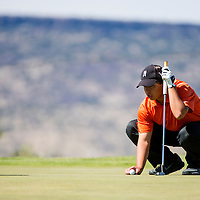 100713      Brian Leddy<br /> Gallup Bengal John Lomasney IV lines up his putt Monday in Grants.