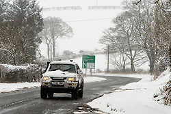 © Licensed to London News Pictures. 24/01/2021. Llanfihangel Nant Melan, Powys, Wales, UK.Motorists drive along the A44 in a winter landscape after overnight snow  near Llanfihangel nant Melan in Powys, Wales, UK. Photo credit: Graham M. Lawrence/LNP