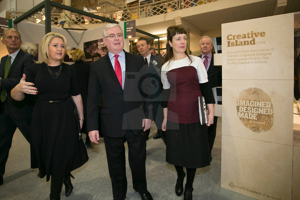 Repro Free: 19/01/2014 Karen Hennessy, Chief Executive (left) and Laura Magahy, Chairman of the Design & Crafts Council of Ireland are pictured with An Tåinaiste and Minister for Foreign Affairs & Trade, Eamon Gilmore T.D. as he officially opened Showcase, Ireland's International Creative Exopo 2014 in the RDS, running from the 19-22 January. Picture Andres Poveda