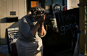 A Minneapolis resident pauses in prayer where George Floyd, an unarmed African-American man was killed by Minneapolis Police Department officers on May 25th, in Minneapolis, Minnesota on Monday, June 1, 2020.