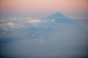 In clear sky days, sunrise is an unforgettable moment in Pico's summit. The perfect triangled shadow of the mountain is projected in the sea and in the clouds.