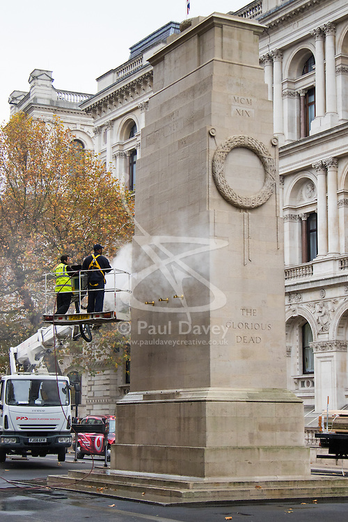 Whitehall, London, November 3rd 2015. Workers jet-wash the London grime from the Cenotaph ahead of Sunday's Remembrance Day ceremonies. // Licencing Contact: paul@pauldaveycreative.co.uk Mobile 07966 016 296