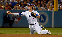 June 27, 2017 - Los Angeles, California, U.S. - Los Angeles Dodgers shortstop Enrique Hernandez throws out Los Angeles Angels' Martin Maldonado (not pictured) in the fifth inning of a Major League baseball game at Dodger Stadium on Tuesday, June 27, 2017 in Los Angeles. (Photo by Keith Birmingham, Pasadena Star-News/SCNG) (Credit Image: © San Gabriel Valley Tribune via ZUMA Wire)