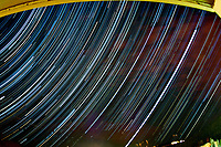 Star Trails from a Hotel in Park City, Utah. Composite of 233 images taken with a Nikon D300 camera and 16 mm f/2.8 fisheye lens (ISO 400, 16 mm, f/2.8, 30 sec). Raw images processed with Capture One Pro and the composite made using the Photoshop CC statistics (maximum) module.