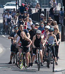 © Licensed to London News Pictures. 09/05/2020. London, UK. Cyclists queue in lines at traffic lights entering Parliament Square in Westminster, London, during lockdown. The government is set to announce measures to ease lockdown, which was introduced to fight the spread of the COVID-19 strain of coronavirus. Photo credit: Ben Cawthra/LNP