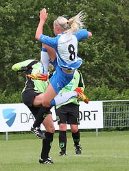 FODBOLD: Karoline Smidt Nielsen (OB) under kampen i 3F Ligaen mellem Taastrup FC og OB den 12. maj 2012 i Taastrup Idrætspark. Foto: Claus Birch