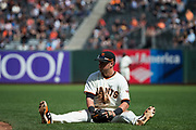San Francisco Giants second baseman Joe Panik (12) dives for a Colorado Rockies ground ball at AT&T Park in San Francisco, California, on September 20, 2017. (Stan Olszewski/Special to S.F. Examiner)