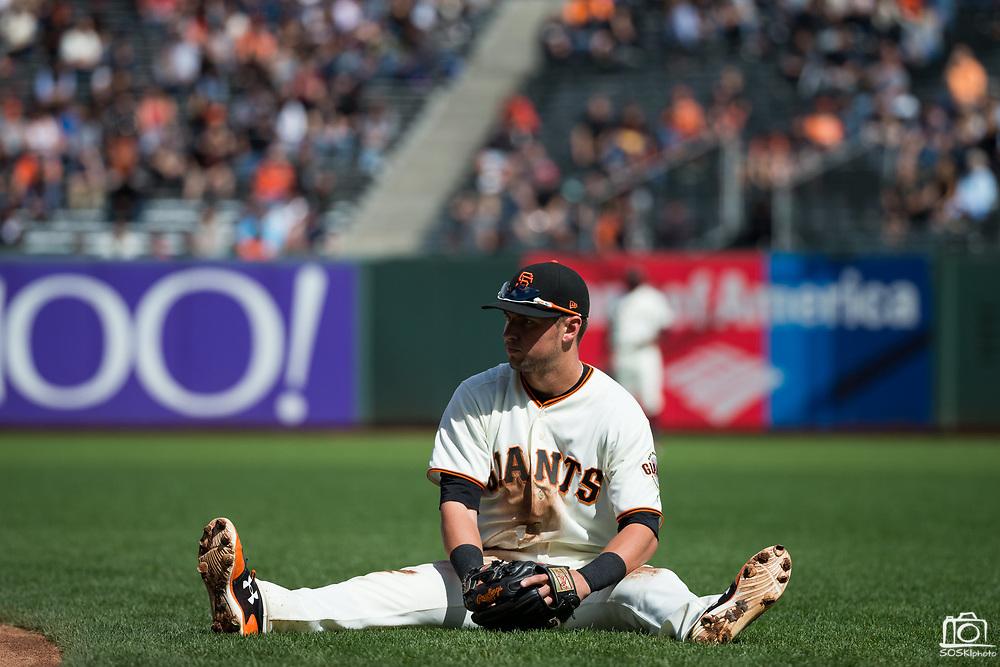 San Francisco Giants second baseman Joe Panik (12) dives for a Colorado Rockies ground ball at AT&T Park in San Francisco, California, on September 20, 2017. (Stan Olszewski/Special to S.F. Examiner)