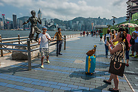 Kowloon, Hong Kong ,China - June 9, 2014: people tourist posing in front of Bruce Lee statue Avenue of Stars Tsim Sha Tsui