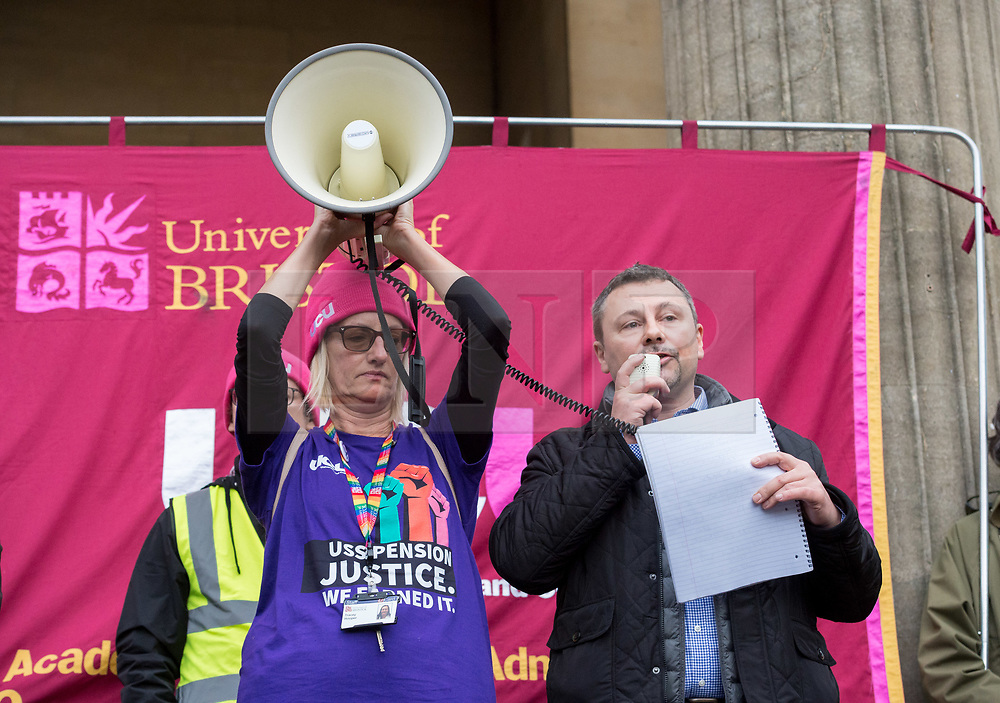 © Licensed to London News Pictures. 25/11/2019. Bristol, UK. University strike across the UK. PAUL BRIDGE, UCU head of HE, speaks at a Rally and march by University and College Union (UCU) members at the University of Bristol with support from students. Strikers gathered outside the university's Victoria Rooms and then marched down Bristol's Park Street past the university's Wills Memorial tower. The disputes is about changes to the Universities Superannuation Scheme (USS) and universities' failure to make improvements on pay, equality, casualisation and workloads. As well as eight strike days from 25 November 2019 to Wednesday 4 December 2019, union members will begin 'action short of a strike'. This involves things like working strictly to contract, not covering for absent colleagues and refusing to reschedule lectures lost to strike action. Photo credit: Simon Chapman/LNP.