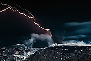 The Dark Lord of Mount Doom - Volcano Eyjafjallajökull erupting in south Iceland, May 2010. Lightnings striking through the black ash moody cloud above the erupting crater