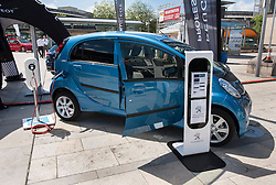 © Licensed to London News Pictures. 06/06/2015. Bristol, UK.  A Peugeot Ion, one of the cheapest electric cars at under £14,000, at a display of electric, hybrid, and low emission vehicles at Bristol's Millennium Square sponsored by EDF energy.  The cars are engineered to produce no or low emissions and pollution to reduce the impact of transport on the environment.  Photo credit : Simon Chapman/LNP