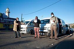 Left to right, pastors Poswa, Mboglela and Ndebele at a taxi rank in Mayville, Diurban, South Africa.