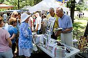 Author Revelle discusses book My Enemy's Child. Svenskarnas Dag Swedish Heritage Day Minnehaha Park Minneapolis Minnesota USA