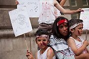 Children dressed up with fake blood to highlight the fact that Israel is killing innocent children in Gaza.<br /> <br /> Tens of thousands of protesters marched in Central London to show their outrage against the Israeli onslaught on Gaza.