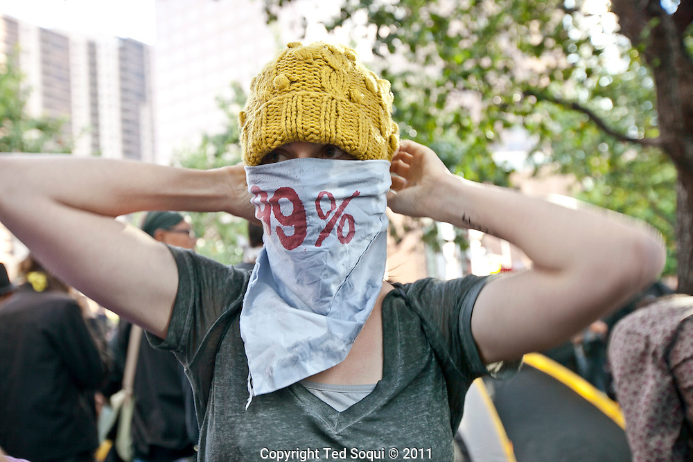 Sarah Mason in grey top at a protest. She would later be featured on the cover of Time Magazine's Person of  the Year..Hundreds of protesters from Occupy LA and several other organizations, held a rally and march in downtown L.A.'s financial center. .The march ended at the Bank of America building where several protesters were arrested for trespassing..Today is a 'National Day of Action,' and many cities around the U.S. held similar types of rallies and marches.Occupy LA protest outside of the Bank of America Building in downtown LA.