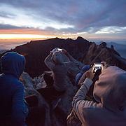 Hikers on Low's Peak for sunrise, Kinabalu Summit Trail, Kinabalu National Park, Borneo, Malaysia.