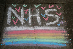 © Licensed to London News Pictures. 13/04/2020. London, UK. Drawings by children on a pavement in north London in support of the NHS. Rainbows are used as a symbol of peace and hope. Coronavirus lockdown continues to slow the spread of COVID-19 and reduce pressure on the NHS. Photo credit: Dinendra Haria/LNP